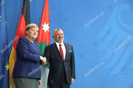 German Chancellor Angela Merkel (L) and Jordan's King Abdullah II (R) shake hands after a press conference at the German chancellery in Berlin, Germany, 17 September 2019. Jordan King Abdullah II is on a visit to Germany.