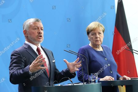 German Chancellor Angela Merkel (R) and Jordan's King Abdullah II (L) attend a press conference at the German chancellery in Berlin, Germany, 17 September 2019. Jordan King Abdullah II is on a visit to Germany.