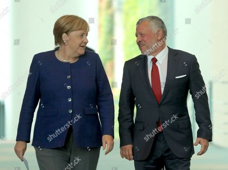 German Chancellor Angela Merkel (L) and Jordan's King Abdullah II (R) arrive for a press conference at the German chancellery in Berlin, Germany, 17 September 2019. Jordan King Abdullah II is on a visit to Germany.