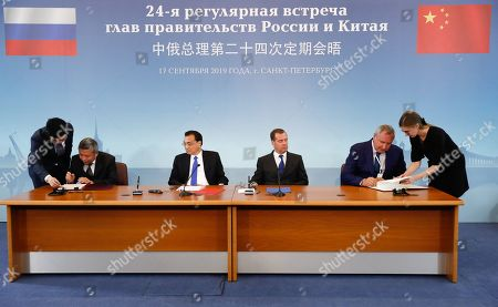 Russian Prime Minister Dmitry Medvedev (C-R), Chinese Premier Li Keqiang (C-L), Russian State Space Corporation ROSCOSMOS Head Dmitry Rogozin (2-R) and Administrator of the China National Space Administration (CNSA) Zhang Kejian (2-L) attend a signing ceremony during the 24th annual meeting of Russian and Chinese heads of government in St. Petersburg, Russia, 17 September 2019. Chinese Premier Li Keqiang is on a 3-day working visit in Russia.