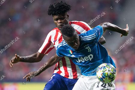 Blaise Matuidi of Juventus FC and Thomas Partey of Atletico de Madrid during the UEFA Champions League football match between Atletico de Madrid and Juventus FC played at the Wanda Metropolitano Stadium in Madrid, on September 18th 2019
