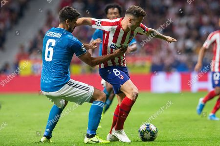 Saul Niguez of Atletico de Madrid and Sami Khedira of Juventus FC during the UEFA Champions League football match between Atletico de Madrid and Juventus FC played at the Wanda Metropolitano Stadium in Madrid, on September 18th 2019