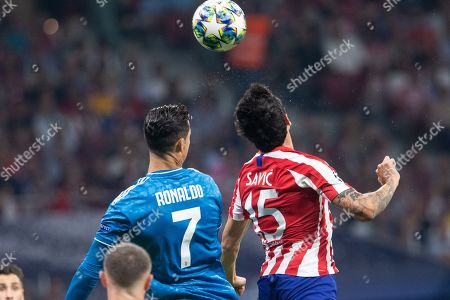 Cristiano Ronaldo of Juventus FC and Stefan Savic of Atletico de Madrid during the UEFA Champions League football match between Atletico de Madrid and Juventus FC played at the Wanda Metropolitano Stadium in Madrid, on September 18th 2019