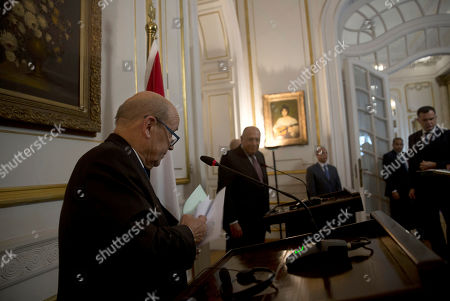 Sameh Shoukry, Jean-Yves Le Drian. French Foreign Minister Jean-Yves Le Drian, left, and Egypt's Foreign Minister Sameh Shoukry, center left, leave a joint press conference, in Cairo, Egypt