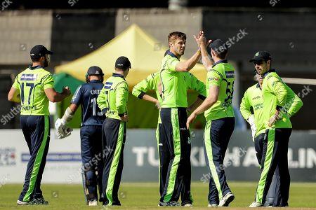 Stock Picture of Ireland vs Scotland. Ireland's Boyd Rankin celebrates with teammates