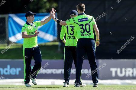 Stock Photo of Ireland vs Scotland. Ireland's Boyd Rankin celebrates with teammates