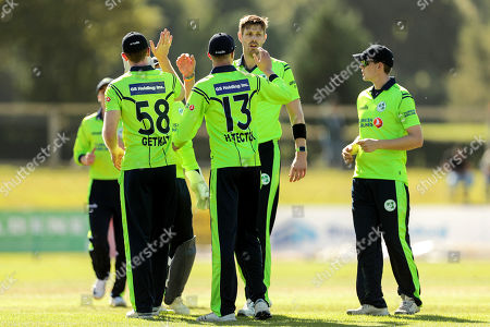 Ireland vs Scotland. Ireland's Shane Getkate celebrates with Boyd Rankin and Harry Tector