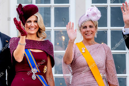 Queen Maxima and Princess Laurentien wave to bystanders from the balcony at Noordeinde Palace