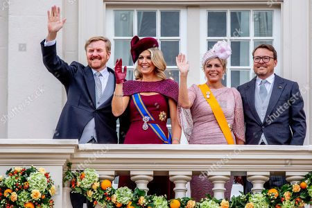 King Willem-Alexander, Queen Maxima, Princess Laurentien and Prince Constantijn wave to bystanders from the balcony at Noordeinde Palace