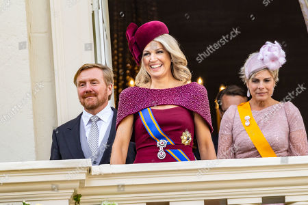 King Willem-Alexander, Queen Maxima and Princess Laurentien wave to bystanders from the balcony at Noordeinde Palace