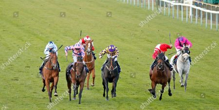 Stock Image of HAN SOLO BERGER (2nd left, Tom Queally) beats EXCELLENT GEORGE (left) and FOXY FOREVER (2nd right) in The Injured Jockeys Fund Handicap Yarmouth