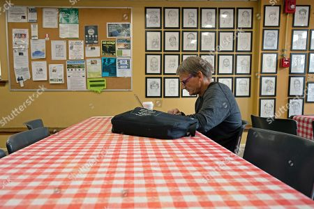 Barry Marchinkoski sits at a table for breakfast at the St. Vincent de Paul soup kitchen in Middletown, Conn. Marchinkoski has been in-and-out of prison and jail, while also being homeless, for most of his life. Nearly half of the people entering homeless shelters in Connecticut in the last three years have spent time inside a state prison or jail at some point in their lives, according to data collected by the state