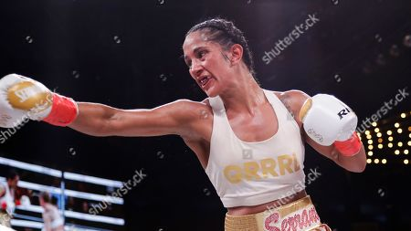 Amanda Serrano during the ninth round of a WBO world female featherweight championship boxing match against Heather Hardy, in New York. Serrano won the fight