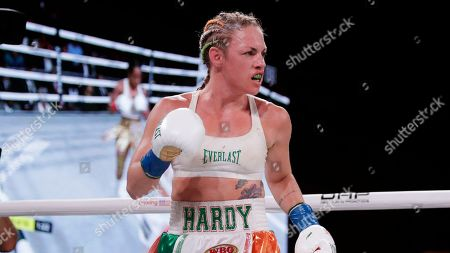 Stock Photo of Heather Hardy during the eighth round of a WBO world female featherweight championship boxing match against Amanda Serrano, in New York. Serrano won the fight