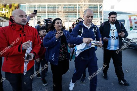 Stock Photo of Head coach of Argentina's national basketball, Sergio Hernandez (2-R), signs autographs to fans on the team's arrival to the International Airport of Ezeiza following the FIBA Basketball World Cup, in Buenos Aires, Argentina, 17 September 2019. Spain defeated Argentina in the FIBA Basketball World Cup final held in Beijing, China, on 15 September.