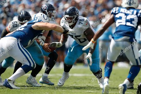 Tennessee Titans offensive guard Rodger Saffold (76) sets to block against the Indianapolis Colts during an NFL football game, in Nashville, Tenn. The Colts won the game 19-17