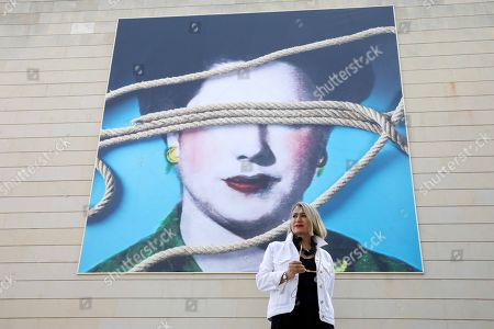 Spanish artist Carmen Calvo, winner of the 2013 National Award for Plastic Arts, poses for the media during the presentation of her artwork 'Los cielos estan cosidos' (lit. The skies are sewn) on the facade of the Valencian Institute of Modern Art (IVAM), in Valencia, eastern Spain, 17 September 2019. The artwork is a portrait of an anonymous woman in the dimensions of 9 by 9 meters. Media reports cited Calvo as saying that she describes it as 'poetic and suggestive' and triggering questions about sexist violence and discrimination.