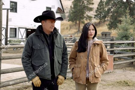 Kevin Costner as John Dutton and Kelsey Chow as Monica Long-Dutton