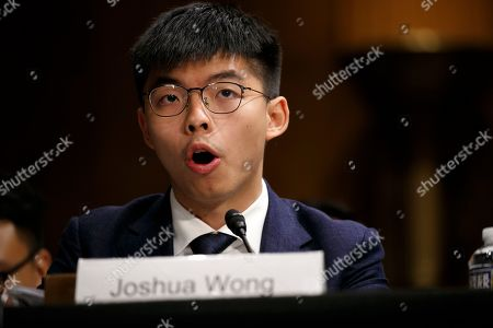 Hong Kong activist Joshua Wong testifies at a congressional hearing, on Capitol Hill in Washington