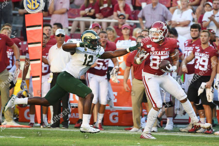 Cheyenne O'Grady, Cam'ron Carter. Arkansas tight end Cheyenne O'Grady slips past Colorado State defender Cam'ron Carter on his way to score a touchdown during the second half of an NCAA college football game, in Fayetteville, Ark