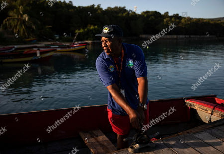 David Murray, president of the Oracabessa Fishers Association and warden for the Oracabessa Fish Sanctuary, prepares to patrol the reef's no-take zone in Oracabessa Bay, Jamaica