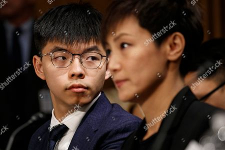 Joshua Wong, Denise Ho. Hong Kong activists Joshua Wong, left, and Denise Ho, attend a Congressional Executive Commission on China (CECC) hearing to examine developments in Hong Kong, on Capitol Hill in Washington