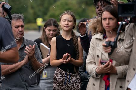 Greta Thunberg, JSA. Swedish activist Greta Thunberg, center, who has called on world leaders to step up their efforts against global warming, applauds remarks by Sen. Ed Markey, D-Mass., chairman of the Senate Climate Change Task Force, at a news conference at the Capitol in Washington