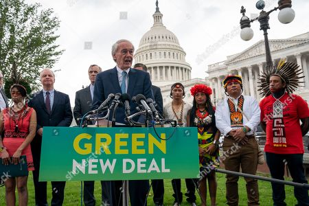 Ed Markey, Chris Van Hollen, Jeff Merkley. Sen. Ed Markey, D-Mass., chairman of the Senate Climate Change Task Force, joined at left by Sen. Chris Van Hollen, D-Md., Sen. Jeff Merkley, D-Ore., and indigenous people of the Americas, at a news conference at the Capitol in Washington