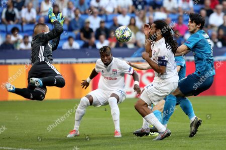 Lyon's Jason Denayer, center right, fails to score during the group G Champions League soccer match between Lyon and Zenit St Petersburg at the Lyon Olympic Stadium in Lyon, France