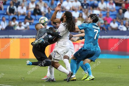 Stock Image of Lyon's Jason Denayer, center, fails to score during the group G Champions League soccer match between Lyon and Zenit St Petersburg at the Lyon Olympic Stadium in Lyon, France