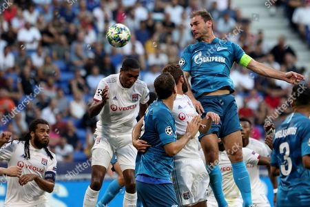 Stock Picture of Zenit's Branislav Ivanovic. center irght, jumps for a header during the group G Champions League soccer match between Lyon and Zenit St Petersburg at the Lyon Olympic Stadium in Lyon, France