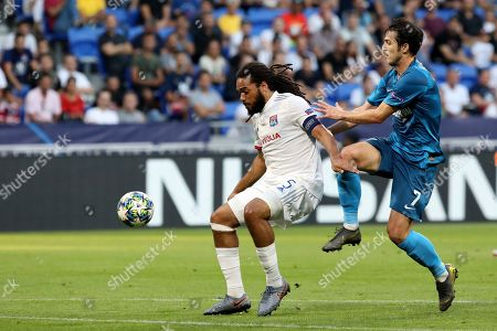 Stock Picture of Lyon's Jason Denayer, left, is challenged by Zenit's Sardar Azmoun during the group G Champions League soccer match between Lyon and Zenit St Petersburg at the Lyon Olympic Stadium in Lyon, France