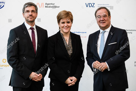 Scotland's First Minister Nicola Sturgeon (C) poses with the Mayor of regional state capital Potsdam Mike Schubert (L) and North Rhine-Westphalia State Premier Armin Laschet (R) of the Christian Democratic Union (CDU) prior to the award ceremony of the international media conference M100 Sanssouci Colloquium, in Potsdam, Brandenburg state, Germany, 17 September 2019. The international forum brings together Europe's top editors, commentators and media owners (print, broadcasting and internet) alongside key public figures to assess the role and impact of the media in international affairs and to promote democracy and freedom of expression and speech. Scotland's First Minister Nicola Sturgeon is awarded for her standing against the Brexit and her commitment to the European Union.
