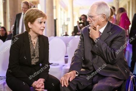 Scotland's First Minister Nicola Sturgeon (L) and the president of the German Parliament 'Bundestag', Wolfgang Schaeuble (R), speak with each other prior to the award ceremony of the international media conference M100 Sanssouci Colloquium, in Potsdam, Brandenburg state, Germany, 17 September 2019. The international forum brings together Europe's top editors, commentators and media owners (print, broadcasting and internet) alongside key public figures to assess the role and impact of the media in international affairs and to promote democracy and freedom of expression and speech. Scotland's First Minister Nicola Sturgeon is awarded for her standing against the Brexit and her commitment to the European Union.