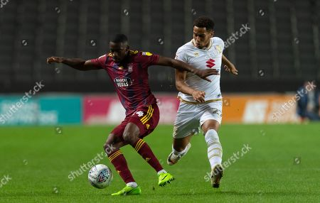 Kane Vincent-Young of Ipswich Town and Sam Nombe of Milton Keynes Dons