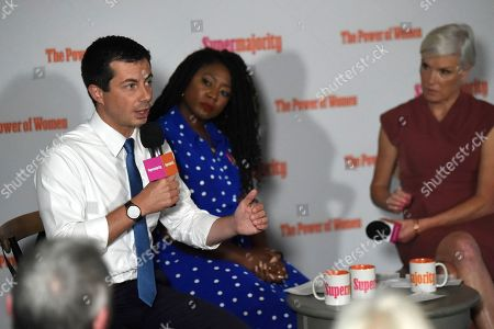 Democratic presidential candidate and South Bend, Indiana, Mayor Pete Buttigieg speaks, as activists Alicia Garza, center, and Cecile Richards, right, look on during an event with Supermajority in Columbia, S.C