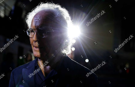 Luciano Benetton, co founder of the Benetton group, stands after the Benetton Spring-Summer 2020 fashion show, unveiled during the fashion week, in Milan, Italy