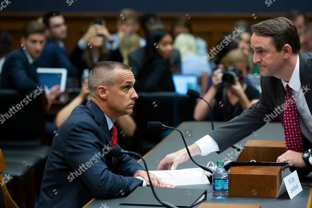 A staffer (R) provides a copy of the report by former special counsel Robert Mueller to former Trump campaign manager Corey Lewandowski (L) during his testimony at the House Judiciary Committee hearing entitled, 'Presidential Obstruction of Justice and Abuse of Power', on Capitol Hill in Washington, DC, USA, 17 September 2019. Former White House Staff Secretary Rob Porter and former White House Deputy Chief of Staff Rick Dearborn, who were both subpoenaed to appear beside Corey Lewandowski, did not show up. The White House has claimed Lewandowski is protected by executive privelege and has been directed not to answer questions regarding conversations on government matters with President Trump or senior administration officials. The committee is seeking information on possible obstruction of justice that former special counsel Robert Mueller detailed in his report.