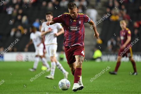 Ipswich Town defender Luke Chambers (4) on defensive duties during the EFL Sky Bet League 1 match between Milton Keynes Dons and Ipswich Town at stadium:mk, Milton Keynes