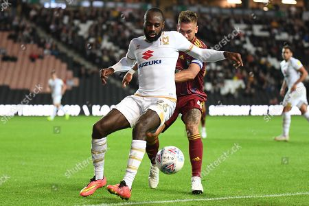 Milton Keynes Dons midfielder Hiram Boateng (26) battles for possession  with Ipswich Town defender Luke Chambers (4) during the EFL Sky Bet League 1 match between Milton Keynes Dons and Ipswich Town at stadium:mk, Milton Keynes