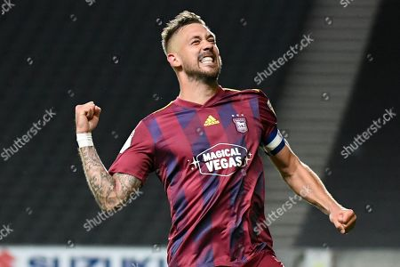 Ipswich Town defender Luke Chambers (4) celebrates with the fans during the EFL Sky Bet League 1 match between Milton Keynes Dons and Ipswich Town at stadium:mk, Milton Keynes
