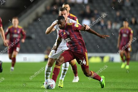 Ipswich Town defender Kane Vincent-Young (24) battles for possession  with Milton Keynes Dons midfielder Brennan Dickenson (11) during the EFL Sky Bet League 1 match between Milton Keynes Dons and Ipswich Town at stadium:mk, Milton Keynes