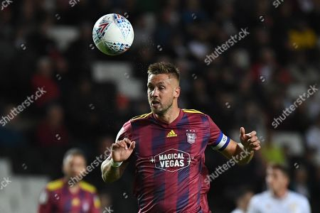 Ipswich Town defender Luke Chambers (4) heads the ball during the EFL Sky Bet League 1 match between Milton Keynes Dons and Ipswich Town at stadium:mk, Milton Keynes
