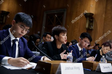 Pro-Democracy activist and Cantopop singer Denise Ho (2-L), with secretary-general of Hong Kong's Demosisto party and leader of the 'Umbrella Movement' Joshua Wong (L), Spokesman for the Hong Kong Higher Education International Affairs Delegation Sunny Cheung (2-R) and executive director of Human Rights in China Sharon Hom (R), delivers remarks during the Congressional-Executive Commission on China's hearing 'Hong Kong's Summer of Discontent and US Policy Responses' on Capitol Hill in Washington, DC, USA, 17 September 2019. The Congressional-Executive Commission on China was created by Congress in October 2000 with the legislative mandate to monitor human rights and the development of the rule of law in China, and to submit an annual report to the President and the Congress.