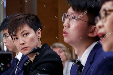 Pro-Democracy activist and Cantopop singer Denise Ho (2-L), listens as executive director of Human Rights in China Sharon Hom (R), delivers remarks during the Congressional-Executive Commission on China's hearing 'Hong Kong's Summer of Discontent and US Policy Responses' on Capitol Hill in Washington, DC, USA, 17 September 2019. The Congressional-Executive Commission on China was created by Congress in October 2000 with the legislative mandate to monitor human rights and the development of the rule of law in China, and to submit an annual report to the President and the Congress.