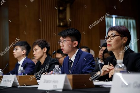Executive director of Human Rights in China Sharon Hom (R), with secretary-general of Hong Kong's Demosisto party and leader of the 'Umbrella Movement' Joshua Wong (L), Pro-Democracy activist and Cantopop singer Denise Ho (2-L), and Spokesman for the Hong Kong Higher Education International Affairs Delegation Sunny Cheung (2-R), delivers remarks during the Congressional-Executive Commission on China's hearing 'Hong Kong's Summer of Discontent and US Policy Responses' on Capitol Hill in Washington, DC, USA, 17 September 2019. The Congressional-Executive Commission on China was created by Congress in October 2000 with the legislative mandate to monitor human rights and the development of the rule of law in China, and to submit an annual report to the President and the Congress.
