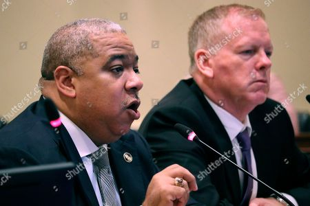 Baltimore Police Commissioner Michael Harrison, left, gives a presentation before the Commission to Restore Trust in Policing during a hearing on in Annapolis, Maryland, with Brian Nadeau, deputy police commissioner, right