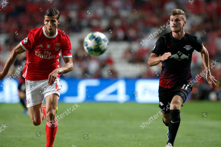 Benfica's Ruben Dias fights for the ball against Leipzig's Timo Werner during the Champions League group G soccer match between Benfica and Leipzig at the Luz stadium in Lisbon