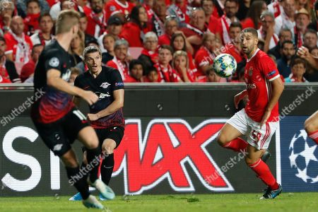 Leipzig's Marcel Sabitzer kicks the ball next to Benfica's Adel Taarabt during the Champions League group G soccer match between Benfica and Leipzig at the Luz stadium in Lisbon