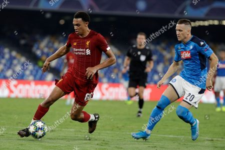 Liverpool's Trent Alexander-Arnold, left, controls the ball as Napoli's Piotr Zielinski looks on during the Champions League Group E soccer match between Napoli and Liverpool, at the San Paolo stadium in Naples, Italy